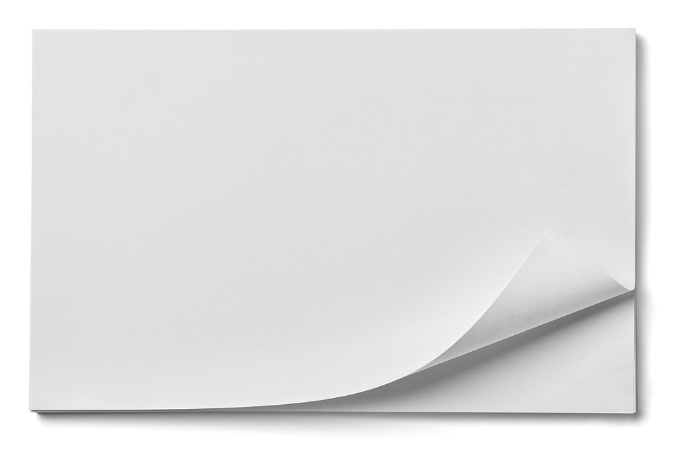 close up of stack of papers with curl on white background 1000x667